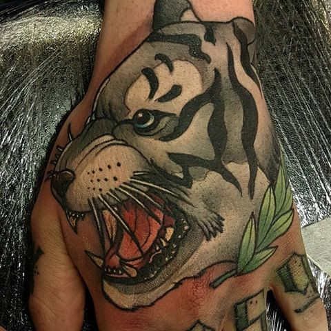 Neo traditional style colored hand tattoo of white tiger
