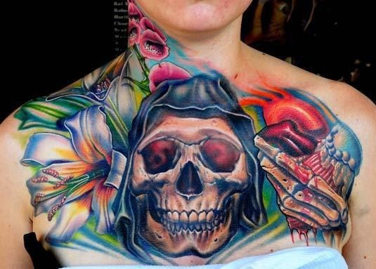 Neo traditional style colored human skull combined with flowers tattoo on chest