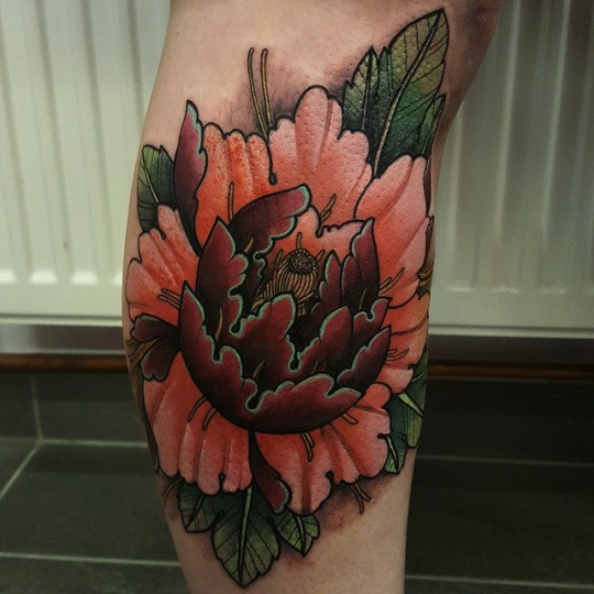 Neo traditional style colored leg tattoo of large flower