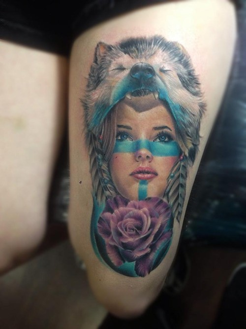 Neo traditional style colored thigh tattoo of woman with wolf helmet and rose