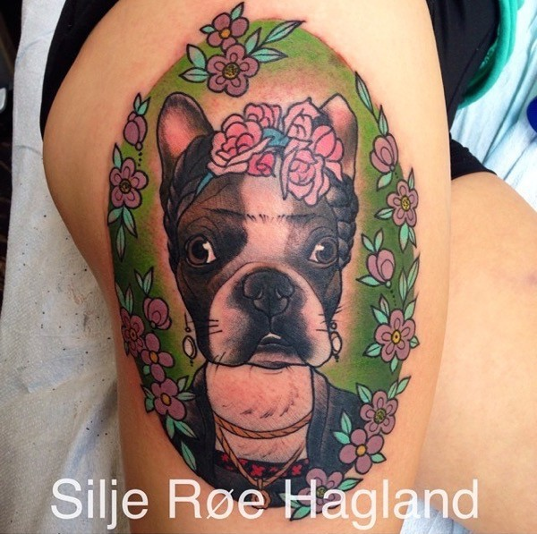 Neo traditional style colored thigh tattoo of female dog with flowers