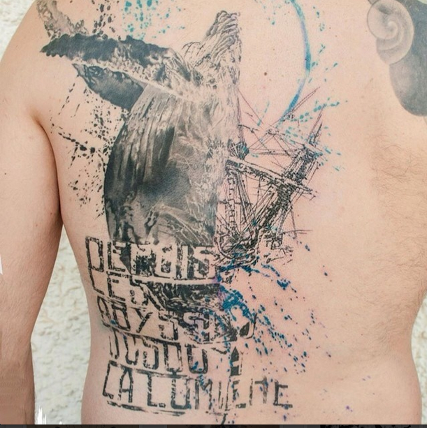 Neo traditional style detailed back tattoo of large whale with lettering and sailing ship