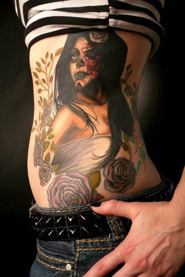 New school colored zombie sexy woman portrait tattoo on side with various flowers