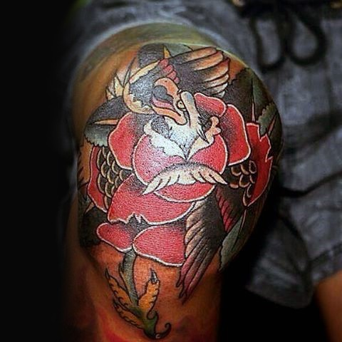 New school illustrative style colored knee tattoo of rose with eagle