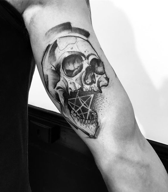 New school style biceps tattoo of human skull combined with geometrical figure