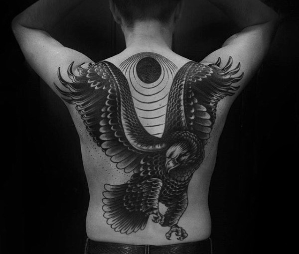 New school style black and white large eagle tattoo on back with dark sun