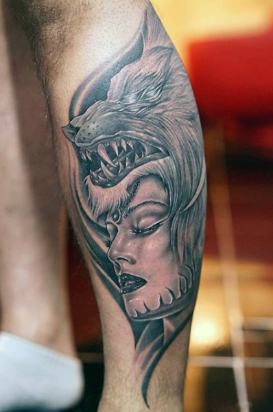 New school style black and white leg tattoo of woman with wolf helmet