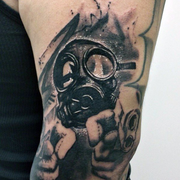 New school style black and white man in gas mask tattoo on shoulder stylized with pistols