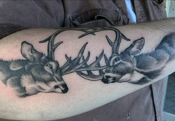 New school style black ink arm tattoo of fighting deers