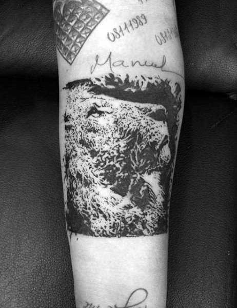 New school style black ink forearm tattoo of lion with lettering
