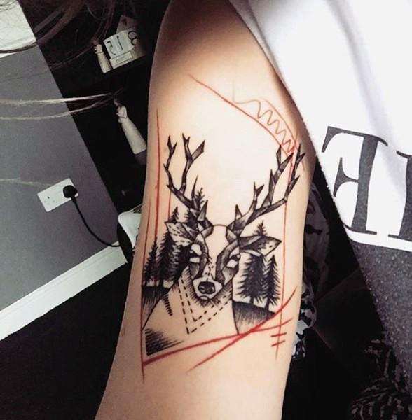New school style black ink shoulder tattoo of deer in dark forest