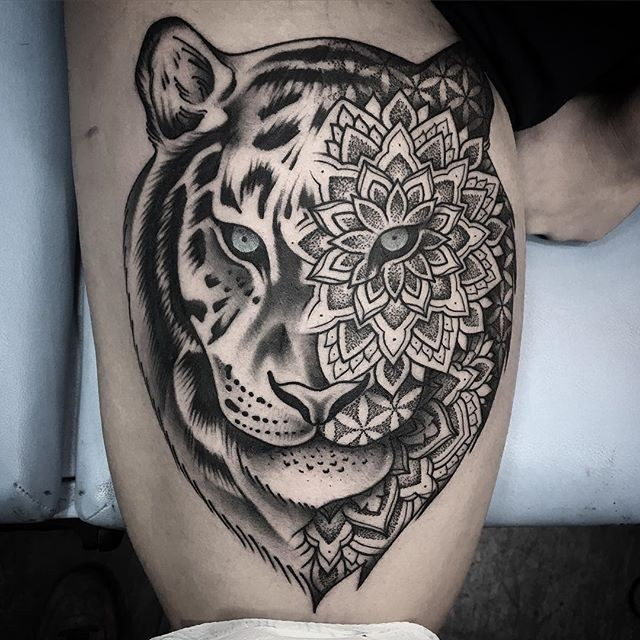 New school style black ink thigh tattoo of tiger stylized with flowers