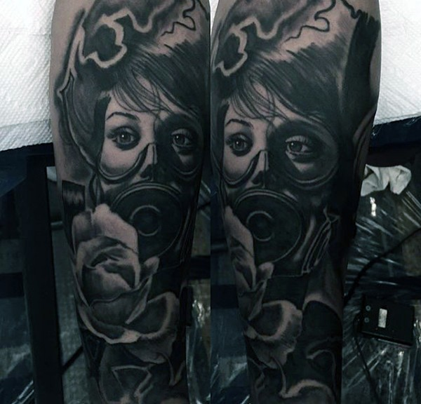 New school style black ink woman in gas mask tattoo on forearm combined with rose flower