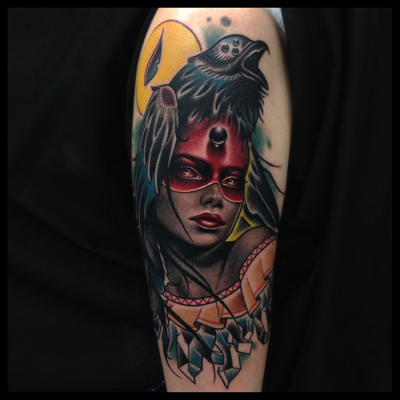 New school style colored arm tattoo of woman with mystic crow