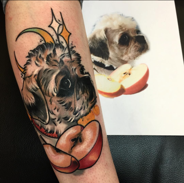 New school style colored arm tattoo of cute dog with apple and moon