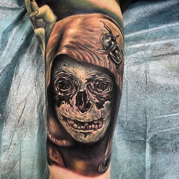 New school style colored arm tattoo of demonic skull with big bug