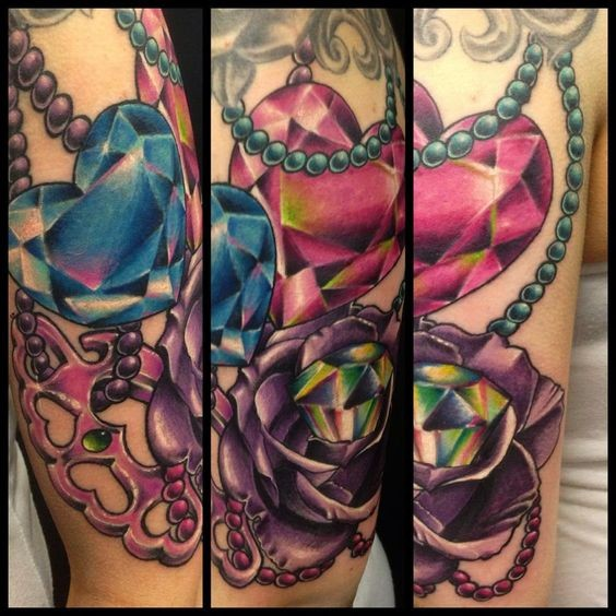 New school style colored arm tattoo of diamonds with rose