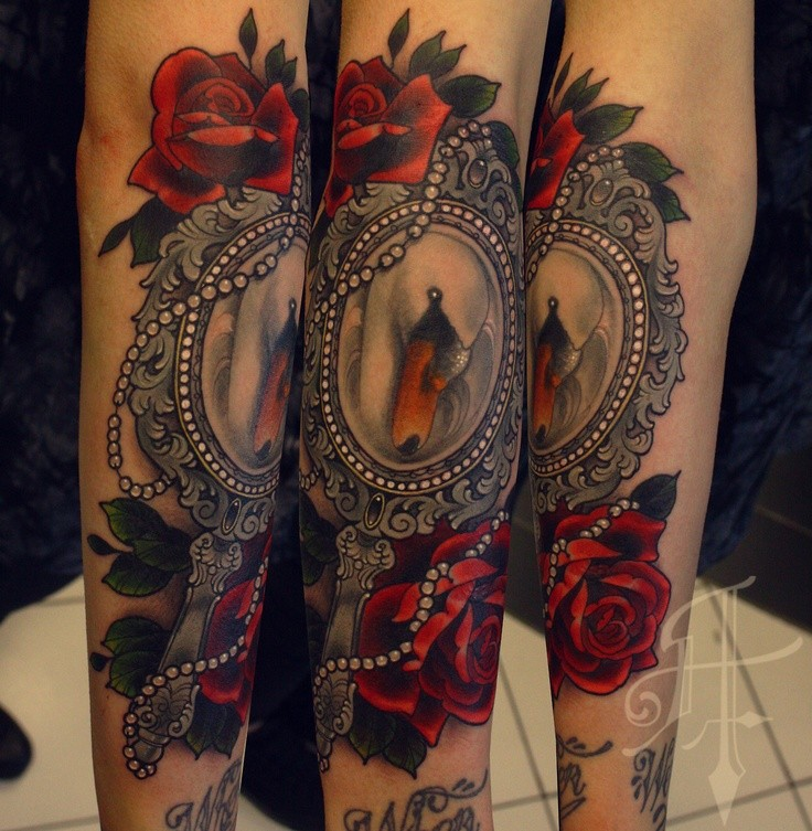 New school style colored arm tattoo of vintage mirror with roses