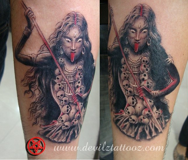 New school style colored arm tattoo of creepy Goddess with skulls