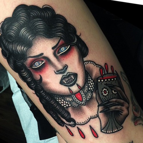 New school style colored arm tattoo of bloody woman vampire