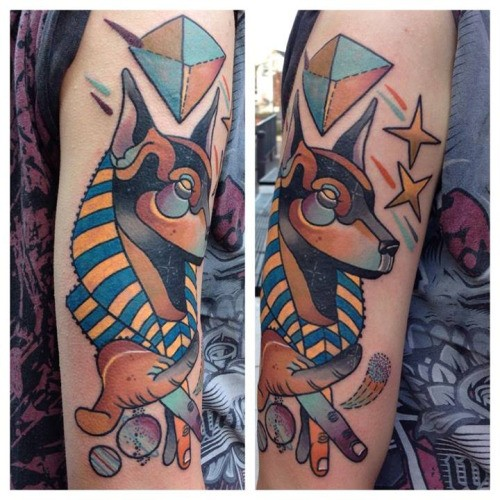New school style colored arm tattoo of Egypt God Anubis with stars