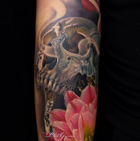 New school style colored arm tattoo of human skull with flowers