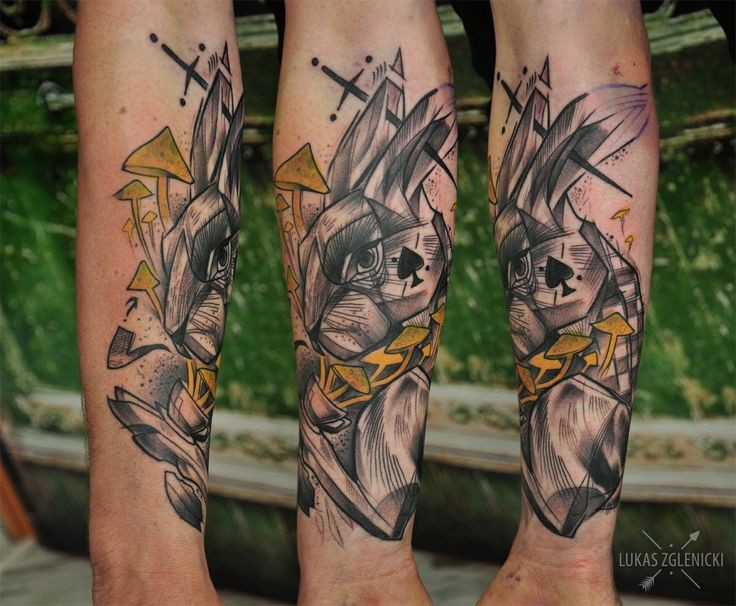 New school style colored arm tattoo of rabbit with heart and sword