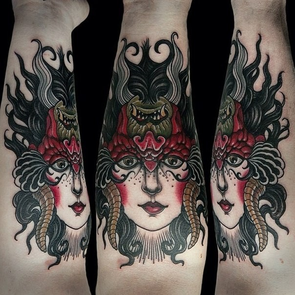 New school style colored arm tattoo of woman face with demonic helmet