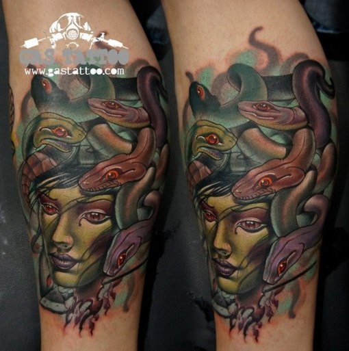 New school style colored arm tattoo of Medusa face and snakes