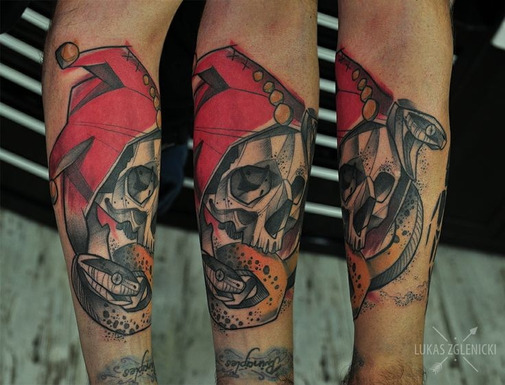 New school style colored arm tattoo of human skull with snake and red hat