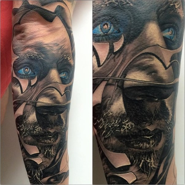 New school style colored arm tattoo of man face with blue eyes