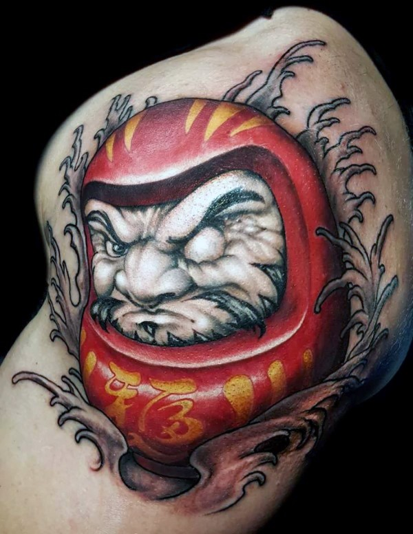 New school style colored biceps tattoo of daruma doll with waves