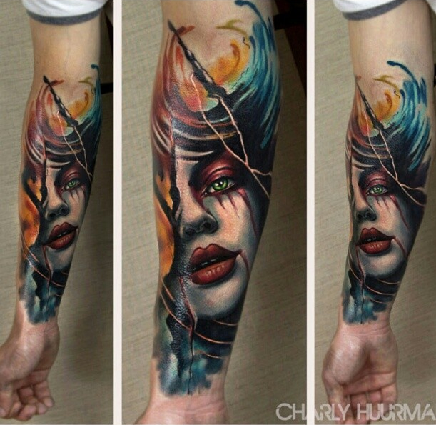 New school style colored bloody woman face tattoo on forearm