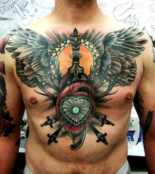 New school style colored chest and belly tattoo of human heart with wings and dagger