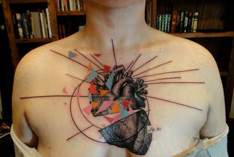 New school style colored chest tattoo of human heart with ornaments