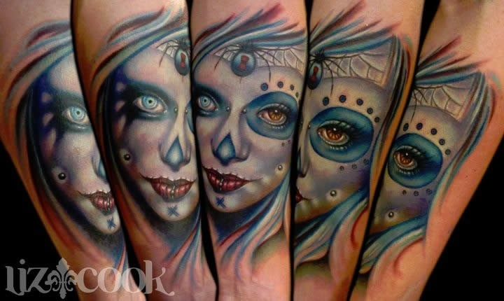 New school style colored creepy looking woman face tattoo on forearm