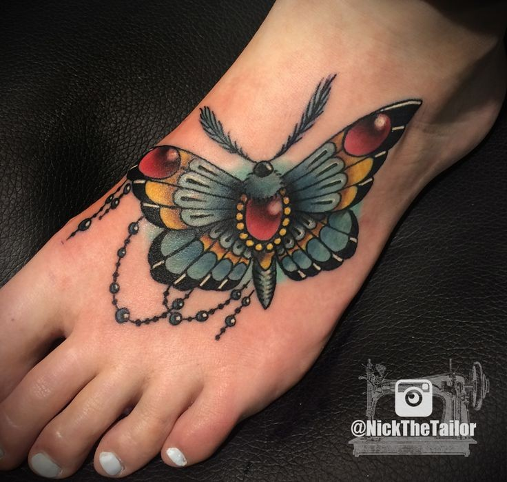 New school style colored foot tattoo of butterfly