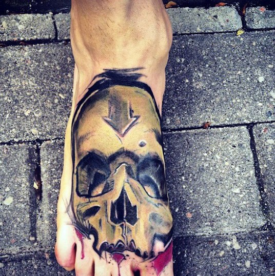 New school style colored foot tattoo of human skull with arrow