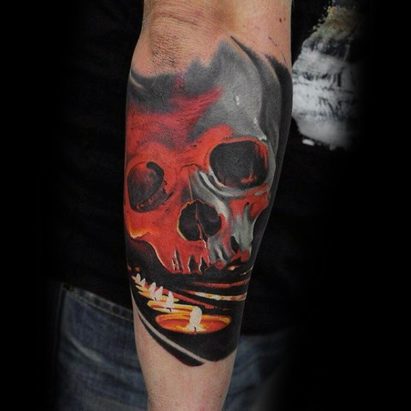 New school style colored forearm tattoo fo human skull and burning candles