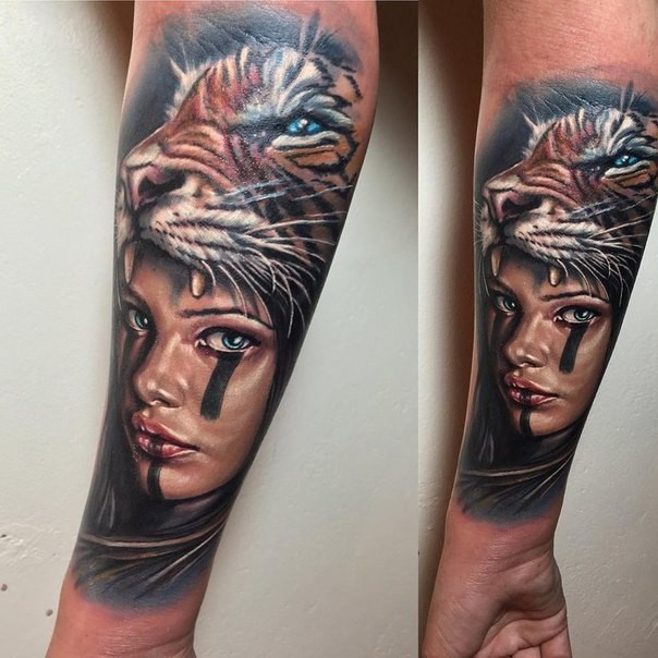 New school style colored forearm tattoo fo woman with tiger skin helmet