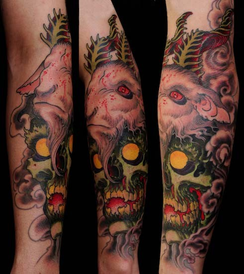 New school style colored forearm tattoo of demonic skull with goat helmet