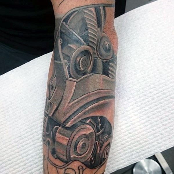 New school style colored forearm tattoo of engine parts