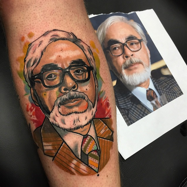 New school style colored forearm tattoo of Asian man portrait