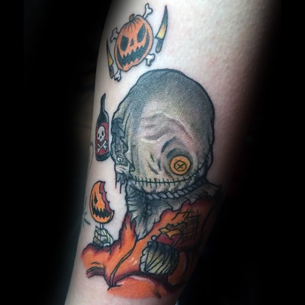 New school style colored forearm tattoo of funny monster with pumpkins