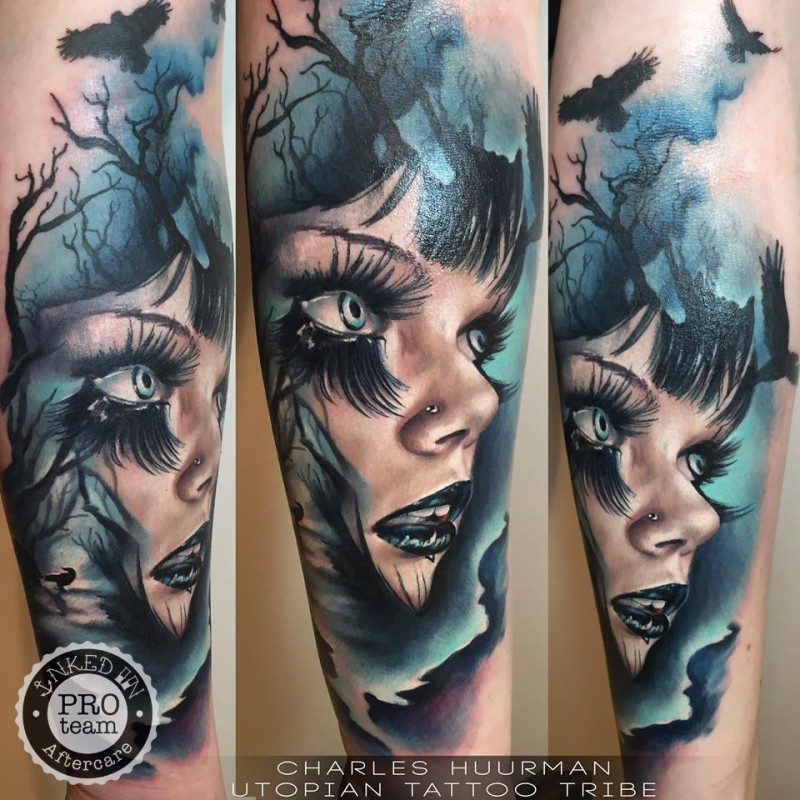 New school style colored forearm tattoo of creepy woman with crows and dark tree