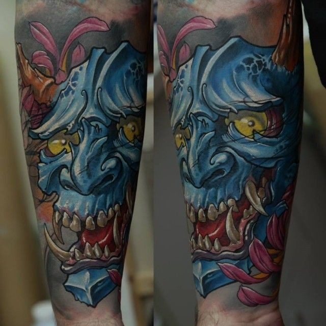 New school style colored forearm tattoo of demonic mask and flowers
