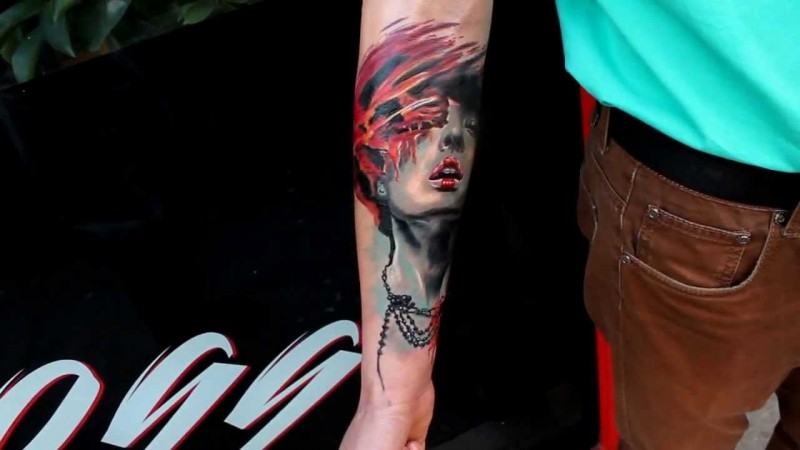 New school style colored forearm tattoo of woman with jewelry