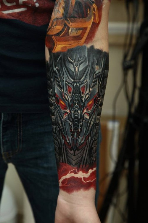 New school style colored forearm tattoo of alien robot