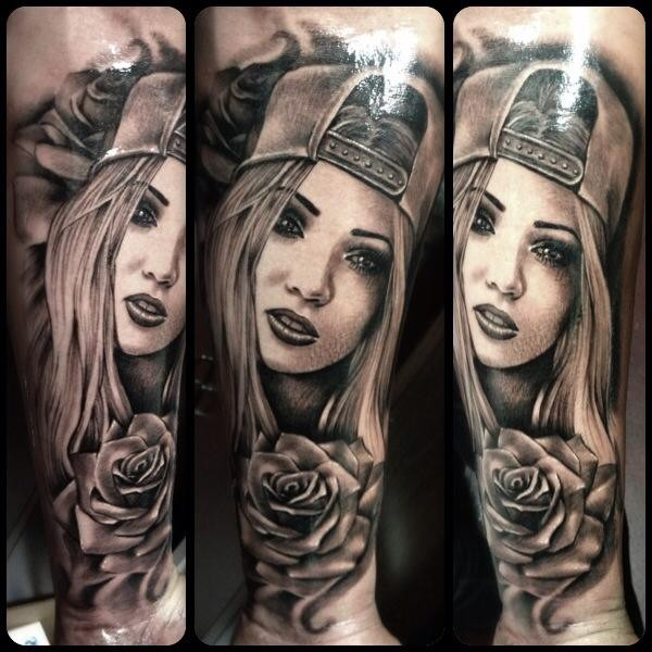 New school style colored forearm tattoo of girl with rose