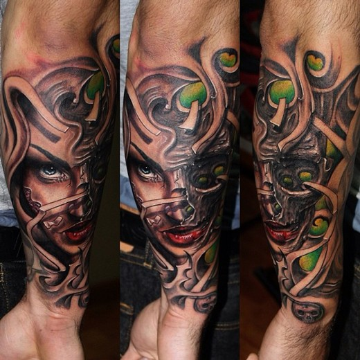 New school style colored forearm tattoo of demonic woman with skulls
